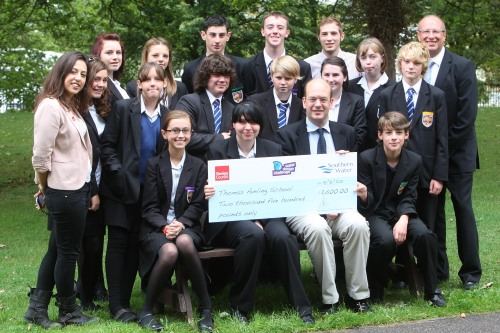 Pupils from Thomas Aveling, together with teacher Peter Humphries, receive their prize money cheque from Mark Reckless MP. Also pictured are Jon Crooke from Southern Water and Bel Read from the Design Council