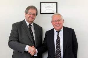 Minister Bob Neill and Cllr Rodney Chambers with plaque at Chatham bus station official opening